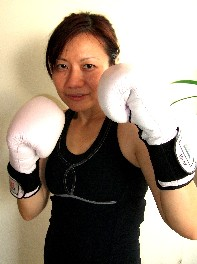 female muay thai trainer